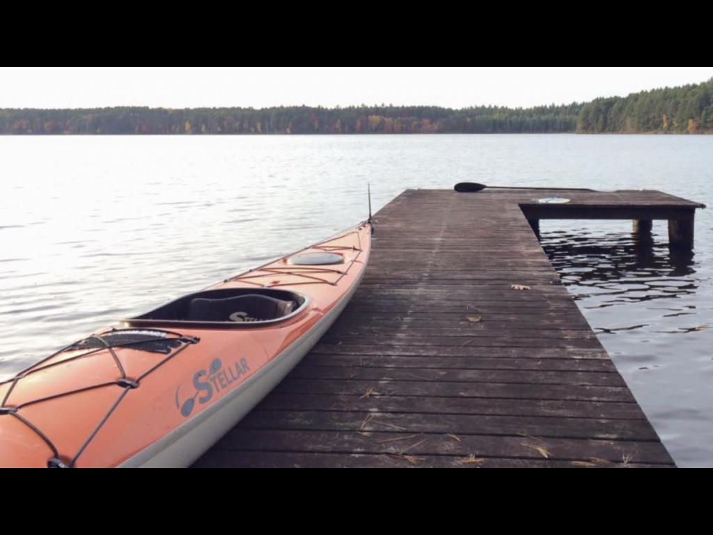 Orange Stellar Kayak on pier.