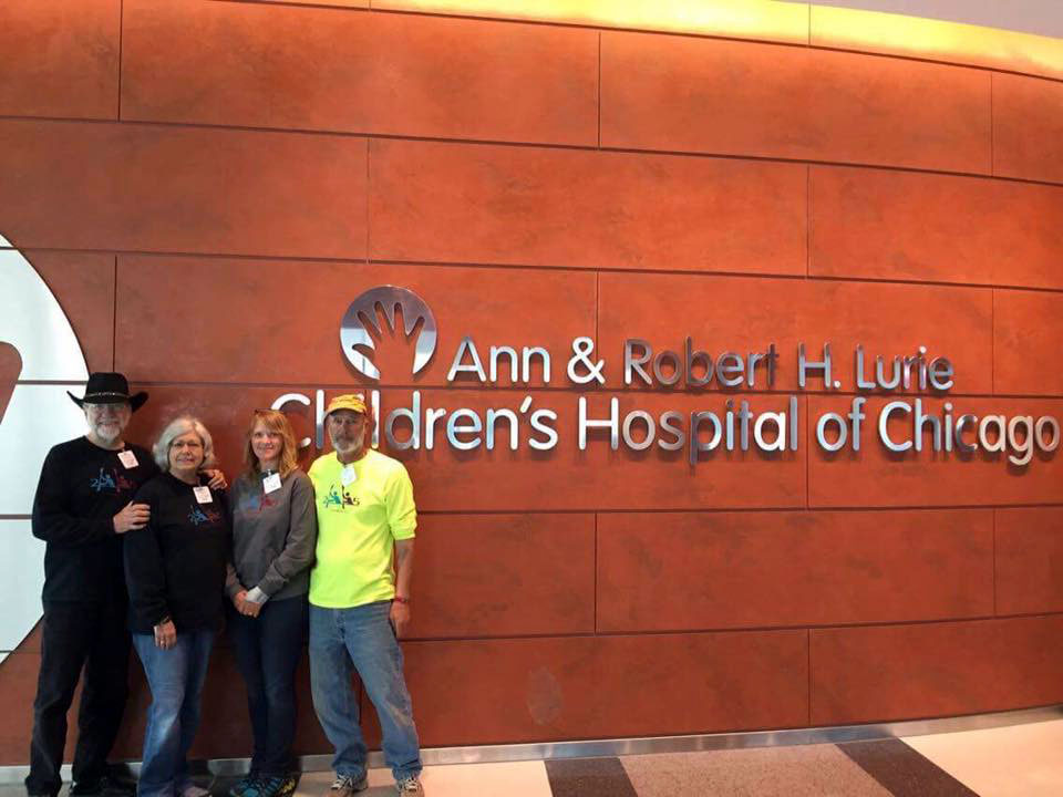 2 Paddling 5 posing next to the Ann & Robert H. Lurie Children's Hospital of Chicago sign in Chicago Illinois.