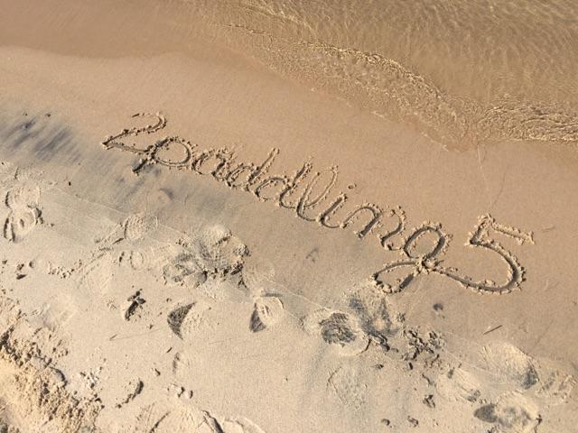2Paddling5 written in the sand on a Lake Michigan beach.