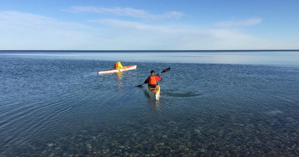 Kayaking out of Orchard Beach State Park Michigan on Lake Michigan.