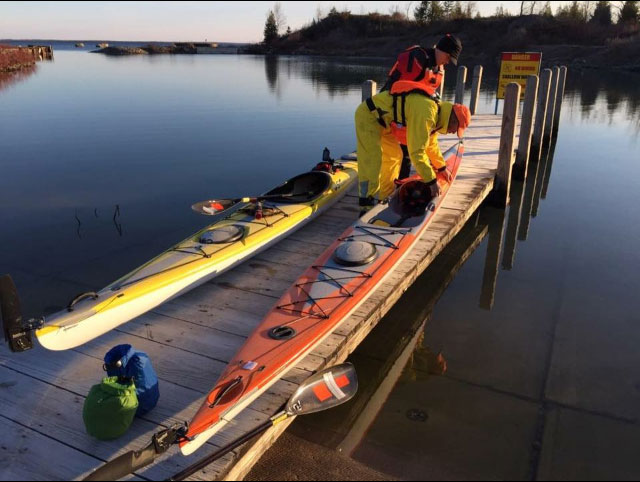 Rock harbor Michigan pier with kayaks.