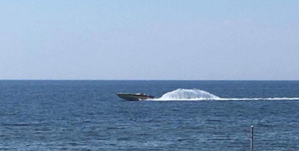 Speed boat on Lake Michigan creating waves.