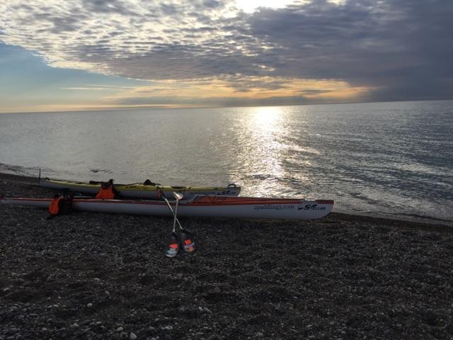Stellar Kayaks on a beach during a Lake Michigan sunrise.