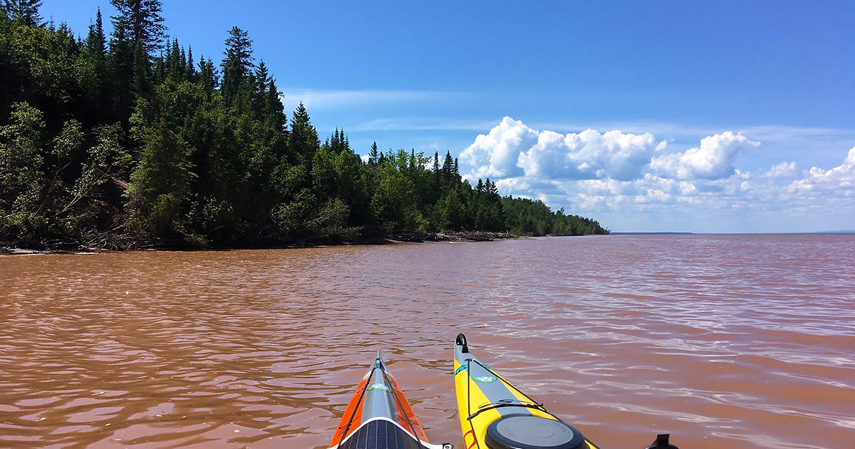 Churned up brown water near Amicon River on Lake Superior.