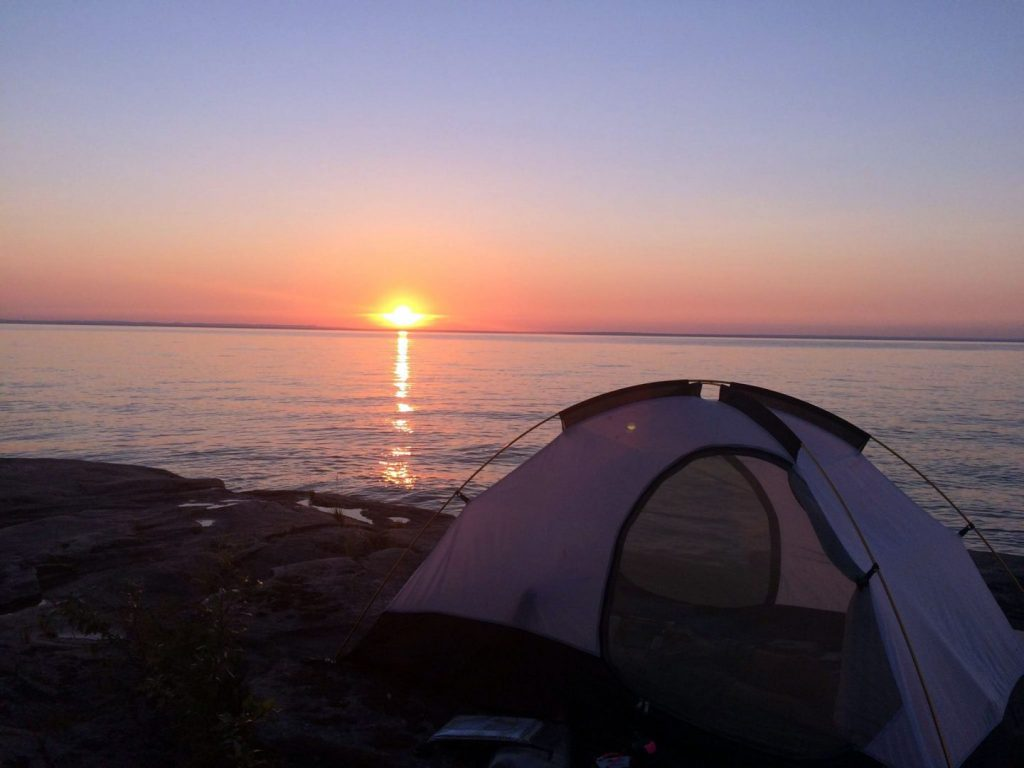 A sunset on Lake Superior while camping on a rock just across Lake Superior from the Portage river.